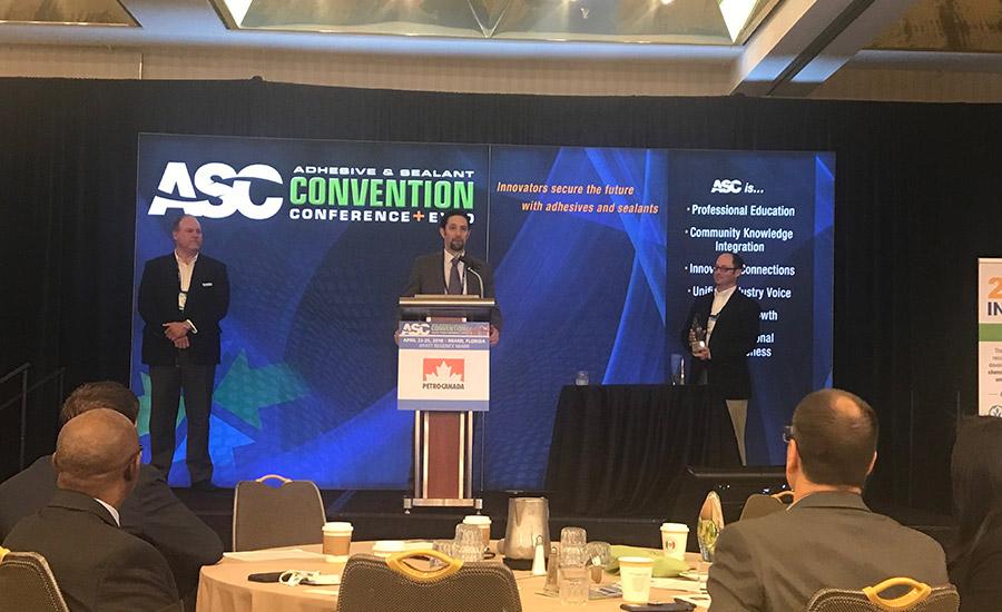 Bostik-ASC-Award---trophy-prepresentation-to-Darius-Deak
