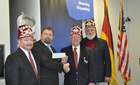 Scheugenpflug-donates-to-the-Shriners-Hospital.jpg