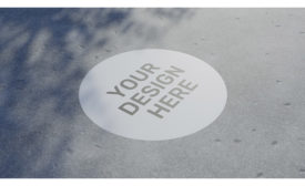 """""""Your Design Here"""" Circle Graphic on Pavement"""