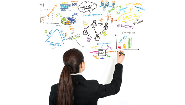 maroon business woman drawing white board